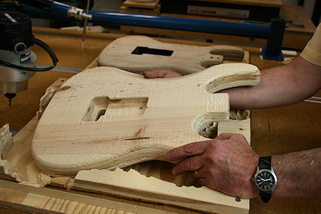 carving an electric guitar